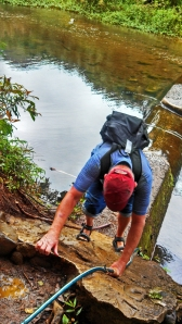 climbing down to cross the river